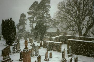 Graveyard during a heavy snow